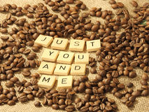 Coffee beans, and the letters JUST YOU AND ME on a hessian background. Melbourne 2017 stock photo