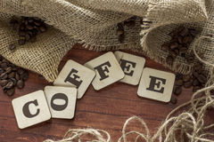 Coffee beans and letters. Coffee beans scattered on the table Royalty Free Stock Images