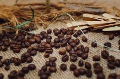 Coffee beans lie on the table, top view. Closeup stock photo