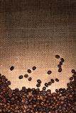 Coffee Beans on Light to Dark Burlap Royalty Free Stock Photo