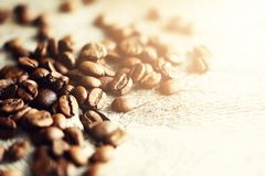 Coffee beans on light wooden background with copyspace for text. Coffee background, food frame, texture concept. Banner.  Stock Image