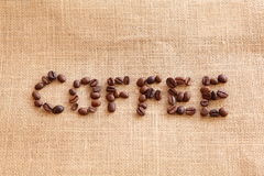 Coffee beans on linen background Stock Images