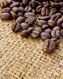 Coffee beans on linen Royalty Free Stock Image