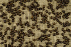 Coffee beans on linen background. Beautiful coffee beans on linen background Stock Photo