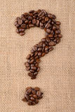 Coffee beans on linen background (question mark). Close-up Royalty Free Stock Photography
