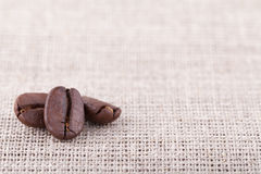 Coffee beans on linen. With a lot of free space to the right and up Stock Images