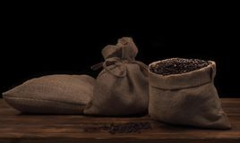 Coffee beans in a linen rustic sack.  Royalty Free Stock Photography