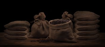 Coffee beans in a linen rustic sack.  Royalty Free Stock Image