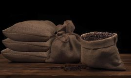 Coffee beans in a linen rustic sack.  Stock Images