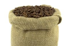 Coffee beans and linen sack. On white background Royalty Free Stock Photography
