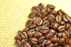 Coffee beans on linen surface. Roasted coffee beans on linen surface Stock Photography