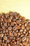 Coffee beans on linen surface. Roasted coffee beans on linen surface Royalty Free Stock Images