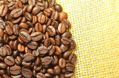 Coffee beans on linen surface. Roasted coffee beans on linen surface Stock Photo
