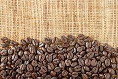 Coffee beans on the linen tablecloth. Top view Royalty Free Stock Images