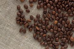 Coffee beans on linen top view Royalty Free Stock Photos