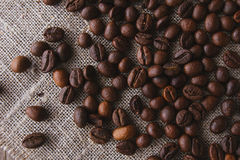 Coffee beans on linen top view Royalty Free Stock Photography
