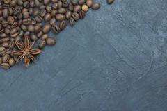 Roasted coffee beans scattering in the corner of the background. beans on a dark background. view from above. copy space stock photography
