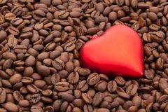 Coffee beans and love symbol. Coffee beans and red heart Stock Photography
