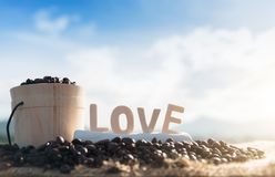 Coffee beans and love on the wooden table stock photos