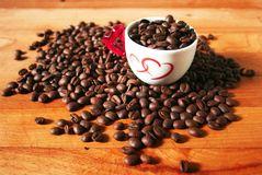 Coffee beans with love cup stock photo