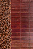 Coffee beans lying on a bamboo mat Stock Photography