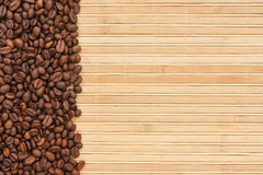 Coffee beans lying on a bamboo mat Stock Image