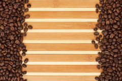 Coffee beans lying on a bamboo mat Stock Photos