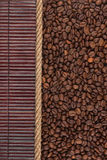 Coffee beans  lying on dark bamboo mat, for menu Stock Photo