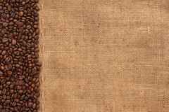 Coffee beans lying on sackcloth. With place for your text Royalty Free Stock Image