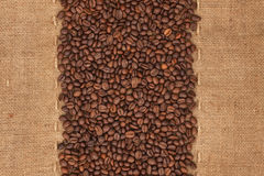 Coffee beans lying on sackcloth. With place for your text Royalty Free Stock Images