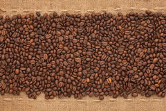 Coffee beans lying on sackcloth Royalty Free Stock Image