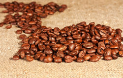 Coffee beans lying on sacking Royalty Free Stock Photos
