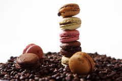 Coffee beans and macarons Stock Photos