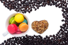 Coffee beans and macaroons Royalty Free Stock Photography