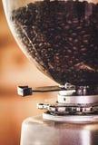 Coffee beans in a coffee machine. Close up coffee beans in a coffee machine Stock Images