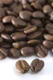 Coffee Beans Macro. Coffee beans on white background. Closeup view with focus on two front beans Stock Image