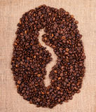 Coffee beans making bean shape on sacking Royalty Free Stock Photos
