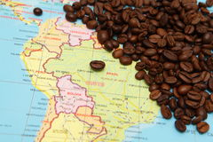 Coffee beans and map Royalty Free Stock Photos