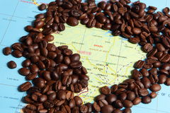 Coffee beans and map Stock Photos