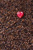 Coffee beans and marzipan heart Royalty Free Stock Photo