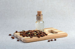 Coffee beans, massage oil in a special glass bottle Stock Photo