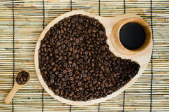 Coffee beans on mat. Royalty Free Stock Photos