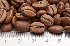 Coffee beans with measuring scale Stock Photo