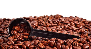 Coffee Beans and Measuring Spoon Royalty Free Stock Photos