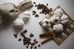 Coffee beans with meringues Stock Photo