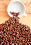Coffee beans. In a mess near the cup Royalty Free Stock Photo