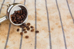 Coffee beans. And metal tool on tablecloth Royalty Free Stock Photo