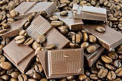 Coffee beans and milk chocolate Stock Photography