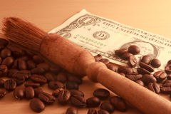 Coffee beans. Money and brown background Stock Photo