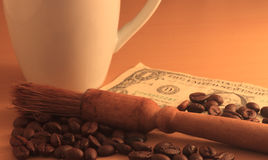 Coffee beans. Money and brown background Royalty Free Stock Image